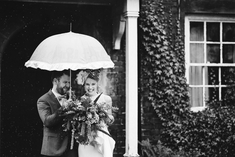 Rainy Rain Umbrella Quirky Stylish Country House Wedding http://www.stevebridgwoodphotography.co.uk/