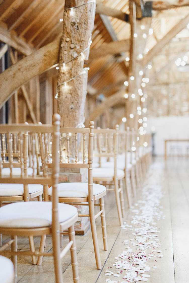 Confetti Petal Aisle Decor Beautiful Rustic Fairy Lights Barn Wedding http://whitestagweddings.com/