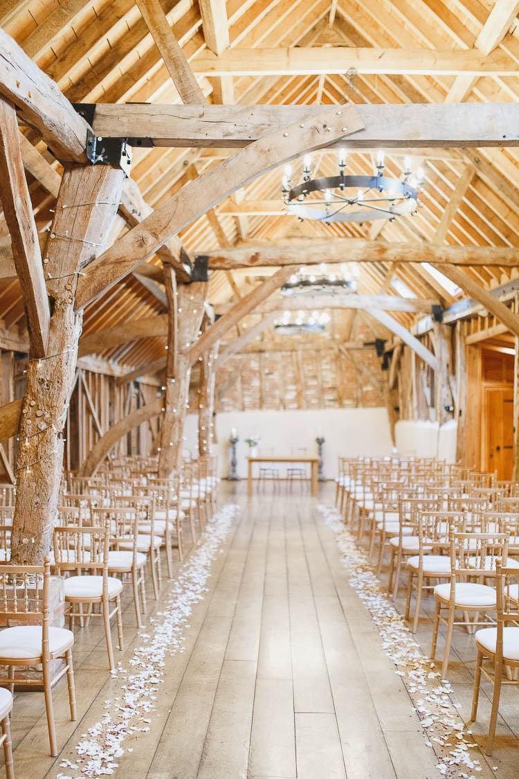 Bassmead Manor Barns Confetti Petal Aisle Beautiful Rustic Fairy Lights Barn Wedding http://whitestagweddings.com/
