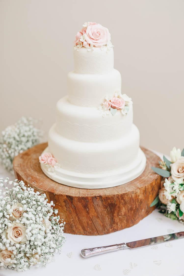 Ivory Lace Cake Flowers LogBeautiful Rustic Fairy Lights Barn Wedding http://whitestagweddings.com/