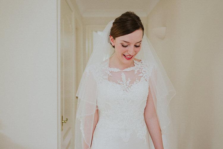 Lace Dress Gown Veil Justin Alexander Stylish Hand Made Rainy Summer Barn Wedding http://www.kategrayphotography.com/