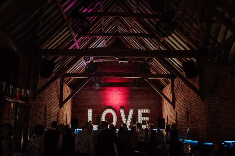 LOVE Letter Lights Barn Stylish Hand Made Rainy Summer Barn Wedding http://www.kategrayphotography.com/