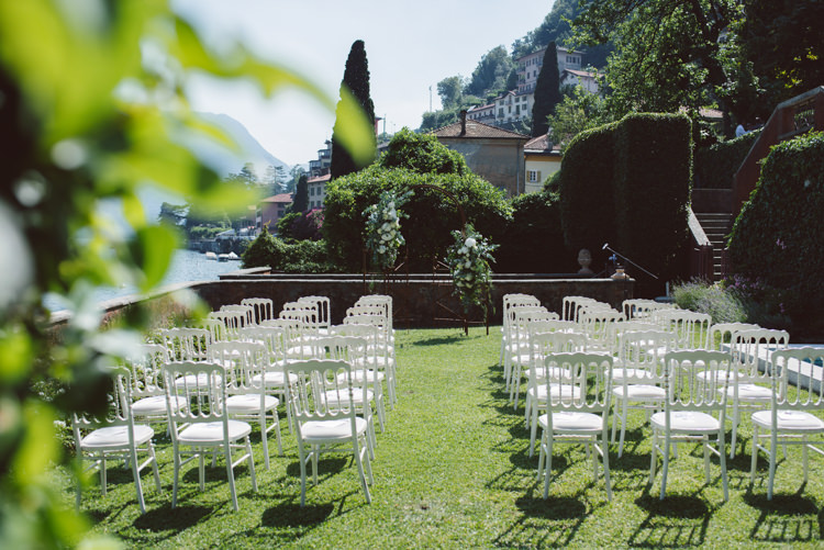 Outdoor Ceremony Rusted Arch White Cream Florals Greenery White Chairs Grass Lake View Botanical Copper Greenery Lake Como Wedding http://margheritacalatiphotography.com/