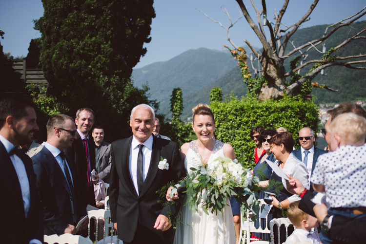 Outdoor Ceremony Bride V Neck Jenny Packham Embellished Bridal Gown Bouquet White Cream Florals Greenery Father Entrance Guests Botanical Copper Greenery Lake Como Wedding http://margheritacalatiphotography.com/