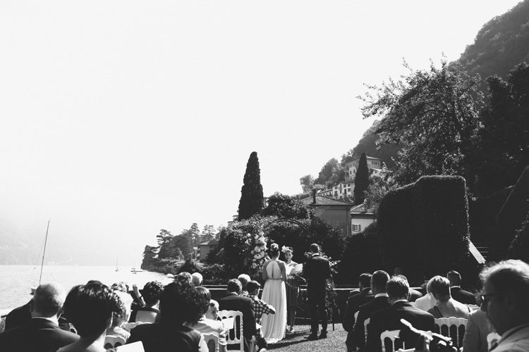 Outdoor Ceremony Bride V Neck Jenny Packham Embellished Bridal Gown Groom Tailored Black Suit Guests Lake View Botanical Copper Greenery Lake Como Wedding http://margheritacalatiphotography.com/
