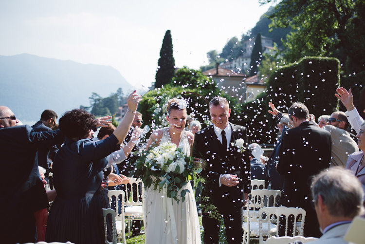 Outdoor Ceremony Bride V Neck Jenny Packham Embellished Bridal Gown Bouquet White Cream Florals Greenery Groom Tailored Black Suit White Shirt Black Tie Floral Buttonhole Confetti Guests Botanical Copper Greenery Lake Como Wedding http://margheritacalatiphotography.com/