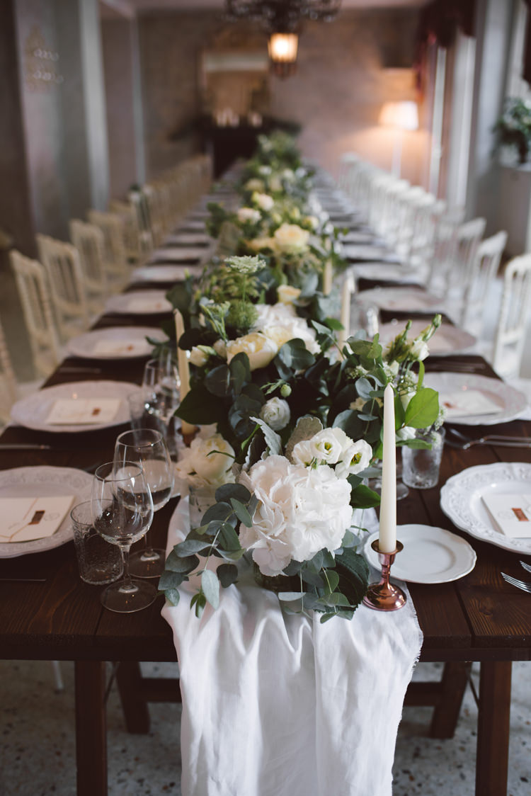 Reception Long Wooden Table White Chairs White Florals Greenery Copper Candlesticks Patterned White China Botanical Copper Greenery Lake Como Wedding http://margheritacalatiphotography.com/