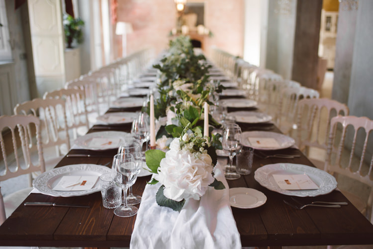 Reception Long Wooden Table White Chairs White Runner White Florals Greenery Candlesticks Patterned China Botanical Copper Greenery Lake Como Wedding http://margheritacalatiphotography.com/