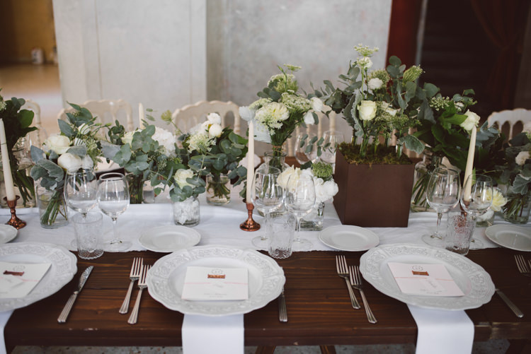 Reception Long Wooden Table White Chairs White Table Runner Copper Candlesticks White Patterned China Botanical Copper Greenery Lake Como Wedding http://margheritacalatiphotography.com/