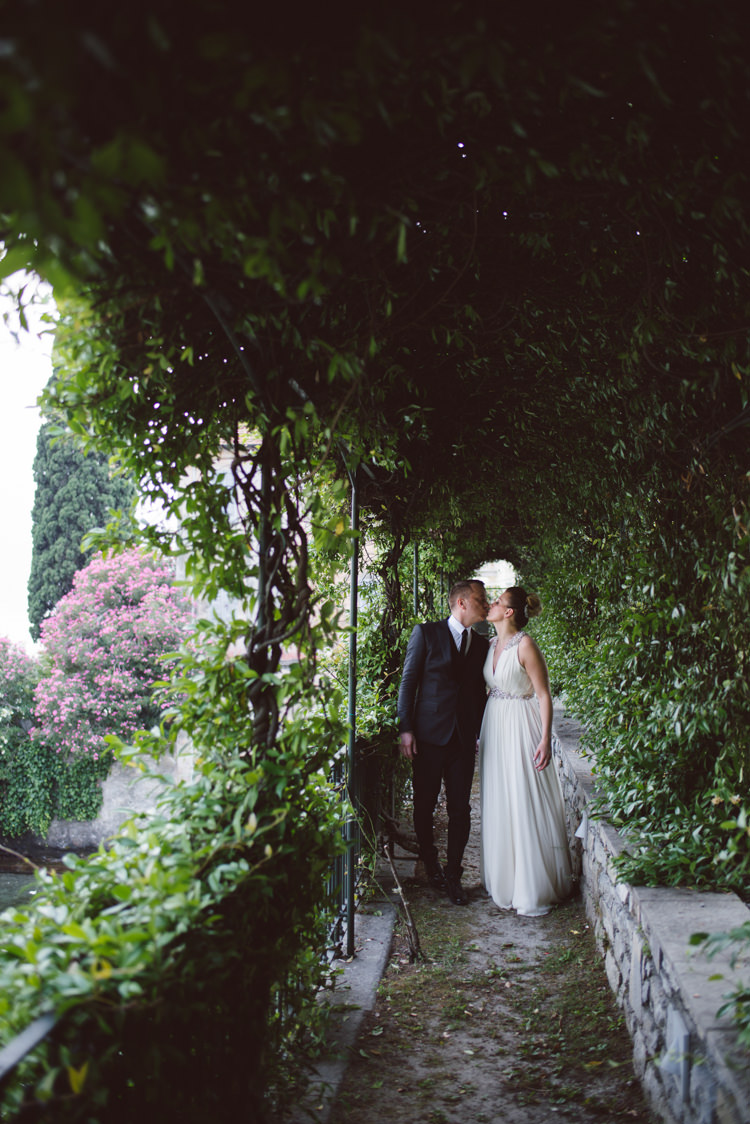 Bride V Neck Jenny Packham Embellished Bridal Gown Groom Tailored Black Suit White Shirt Black Tie Botanical Copper Greenery Lake Como Wedding http://margheritacalatiphotography.com/