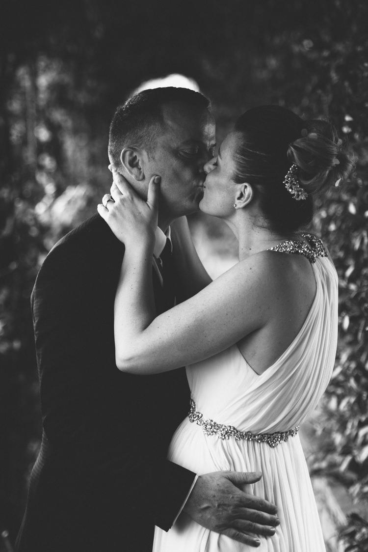 Bride V Neck Jenny Packham Embellished Bridal Gown Crystal Hairpiece Groom Tailored Black Suit White Shirt Black Tie Botanical Copper Greenery Lake Como Wedding http://margheritacalatiphotography.com/