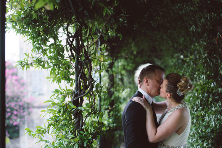 Bride V Neck Jenny Packham Embellished Bridal Gown Crystal Hairpiece Groom Tailored Black Suit White Shirt Black Tie Botanical Copper Greenery Lake Como Wedding http://margheritacalatiphotography.com/