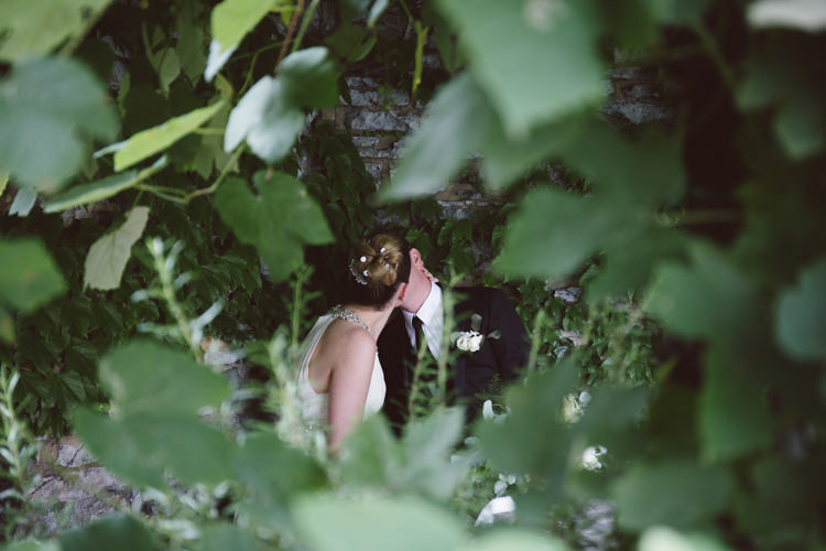 Bride V Neck Jenny Packham Embellished Bridal Gown Groom Tailored Black Suit White Shirt Black Tie Floral Buttonhole Botanical Copper Greenery Lake Como Wedding http://margheritacalatiphotography.com/
