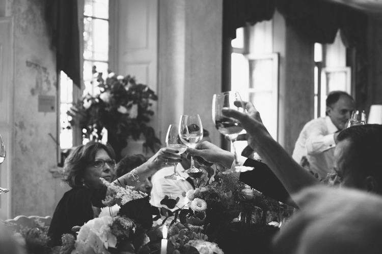 Reception Guests White Florals Greenery Wine Glasses Cheers Botanical Copper Greenery Lake Como Wedding http://margheritacalatiphotography.com/