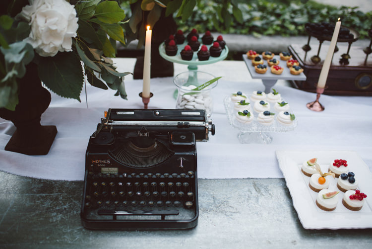 Reception Dessert Table Vintage Typewriter White Florals Greenery Copper Candlesticks Botanical Copper Greenery Lake Como Wedding http://margheritacalatiphotography.com/