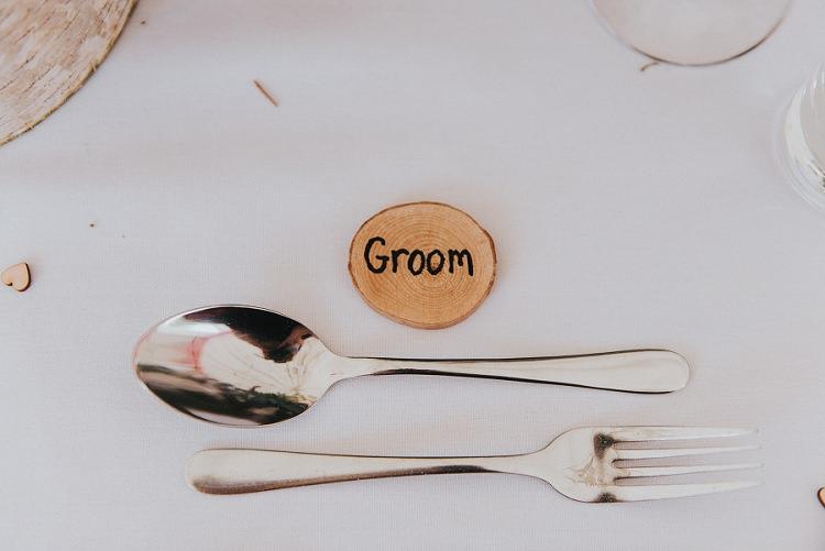 Log Slice Place Name Setting Enchanting Woodland Boho Wedding http://www.kerrydiamondphotography.com/