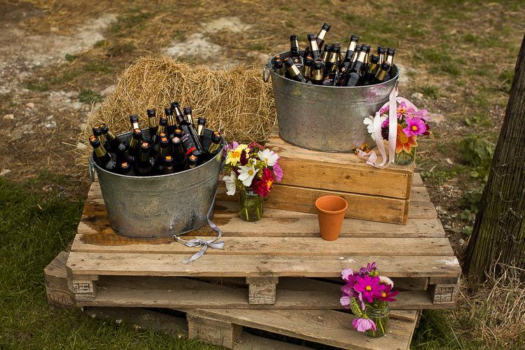 Booze Barrel Crate Flowers Fun Multicolour Creative Barn Wedding http://www.mattparryphotography.co.uk/