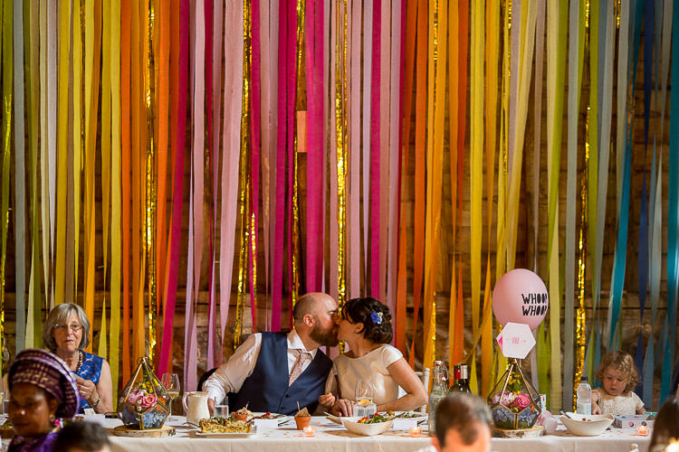 Rainbow Ribbon Backdrop Top Table Fun Multicolour Creative Barn Wedding http://www.mattparryphotography.co.uk/