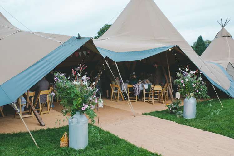 Tipi Urn Flowers Delightfully Natural Pretty Garden Wedding http://www.elliegracephotography.co.uk/