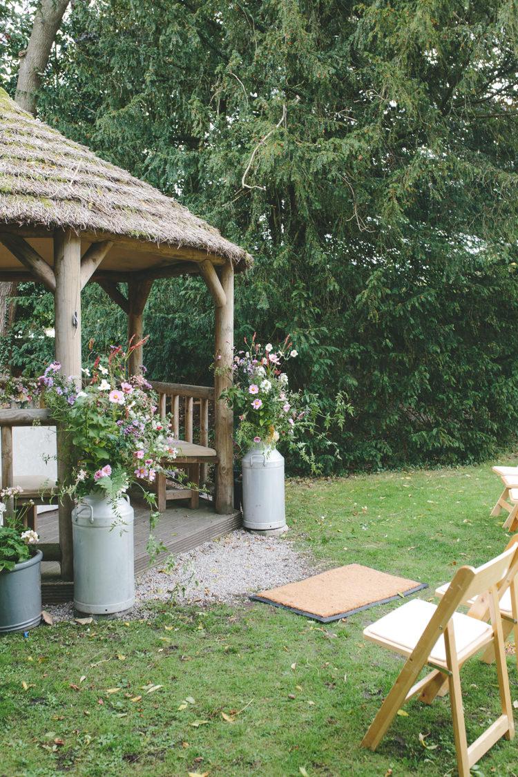 Urn Flowers Outdoor Ceremony UK Delightfully Natural Pretty Garden Wedding http://www.elliegracephotography.co.uk/