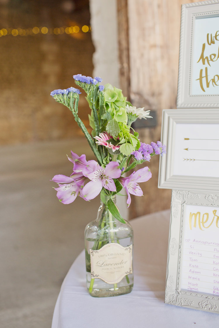 Lavender Bottle VIntage Flowers Details Table Plan Colour Pop Summer French Chateau Wedding http://www.cottoncandyweddings.co.uk/