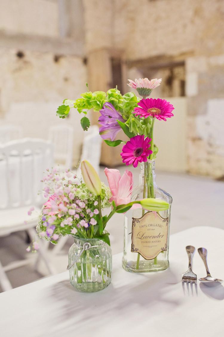 Vintage Lavender Bottle Flowers Table Decoration Centre Colour Pop Summer French Chateau Wedding http://www.cottoncandyweddings.co.uk/
