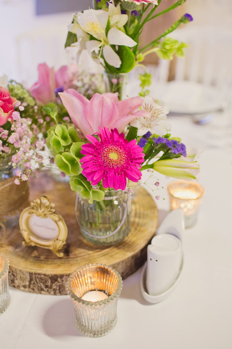 Table Centre Pink Purple Flower Jar Frame Candle Log Colour Pop Summer French Chateau Wedding http://www.cottoncandyweddings.co.uk/