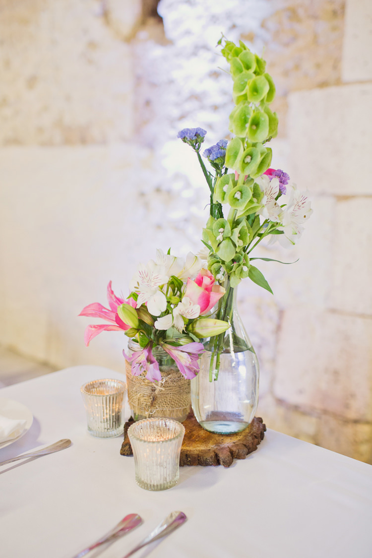 Table Decoration Bottle Flowers Hessian Twine Wood Slice Votive Candle Colour Pop Summer French Chateau Wedding http://www.cottoncandyweddings.co.uk/