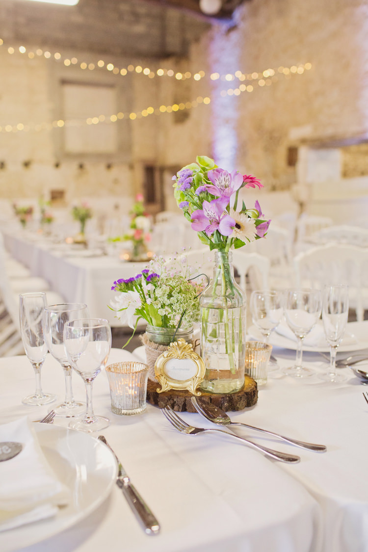 Table Centre Flowers Frame Bottle Hessian Twine Candle Votive Wood Slice Colour Pop Summer French Chateau Wedding http://www.cottoncandyweddings.co.uk/