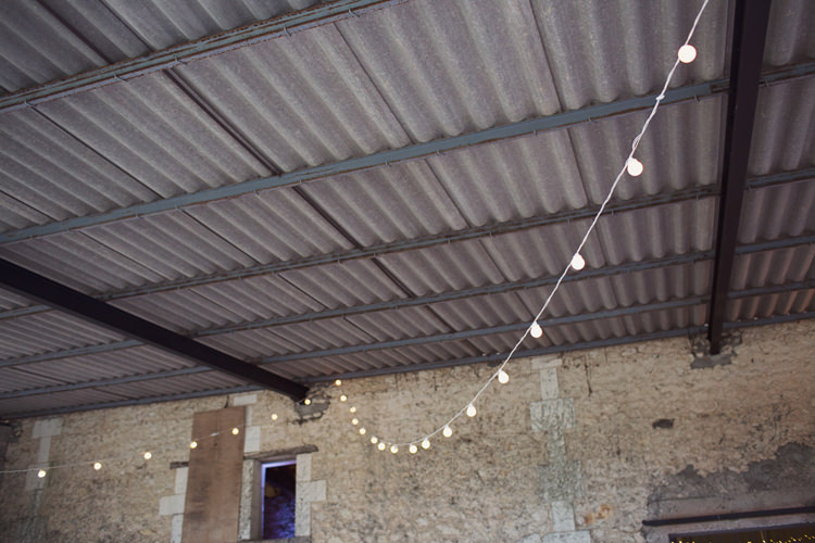 Barn Festoon Lighting Fairy Lights Colour Pop Summer French Chateau Wedding http://www.cottoncandyweddings.co.uk/