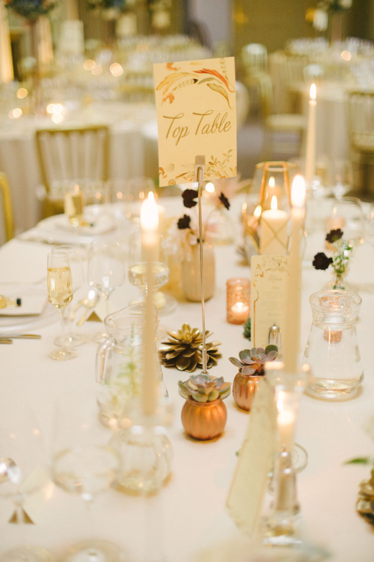 Votives Gold Candles Succulent Flowers Decor Table Name Opulent Metallics City Library Wedding http://www.croandkowlove.com/