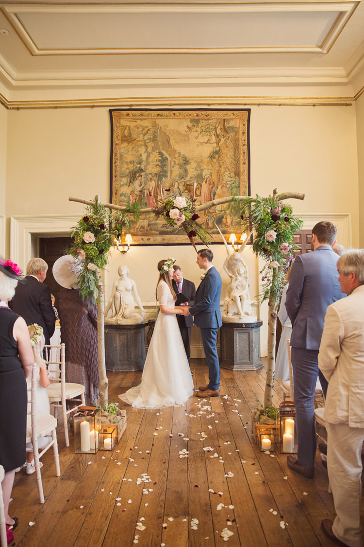 Red Burgundy Dahlia Blush Arch Branch Flowers Ceremony Backdrop Foliage Rose Antler Feather Stunning Countryside Wedding http://www.cottoncandyweddings.co.uk/