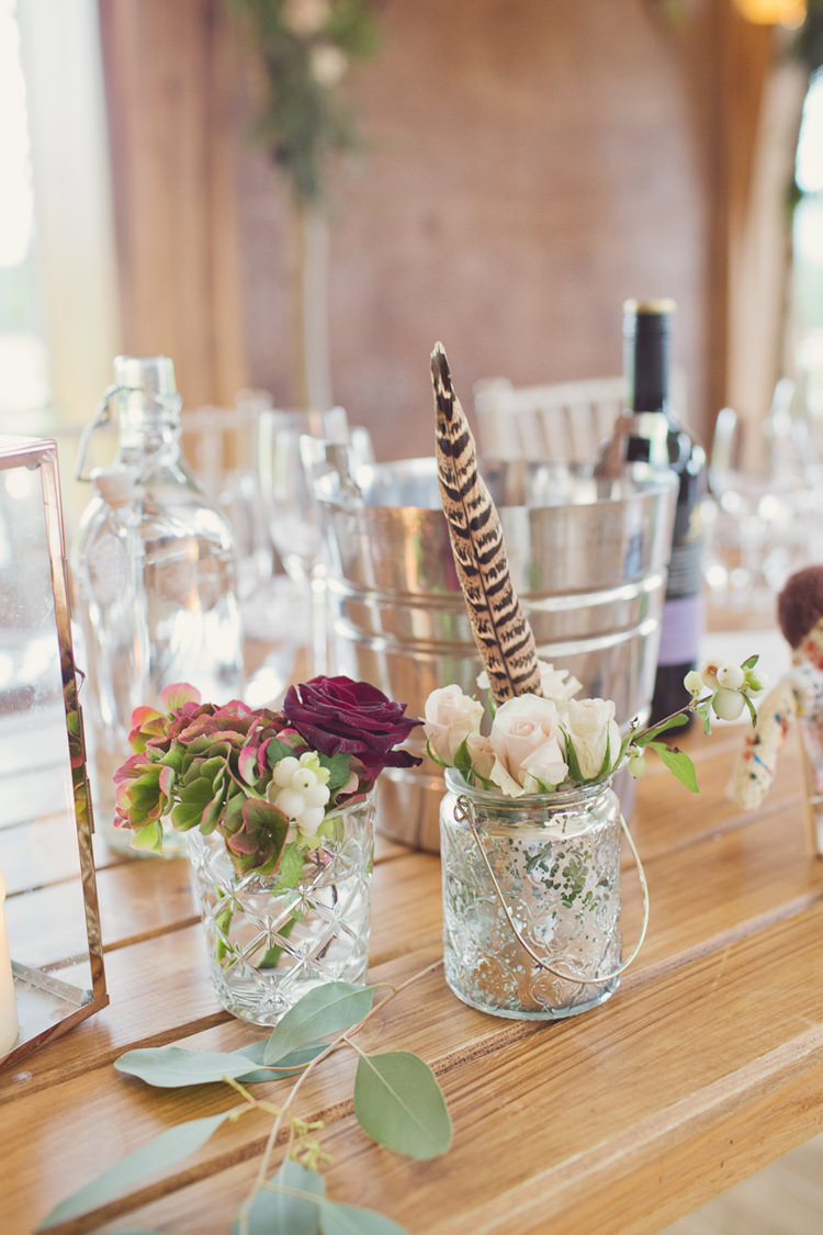 Jar Flowers Tables Antler Feather Stunning Countryside Wedding http://www.cottoncandyweddings.co.uk/