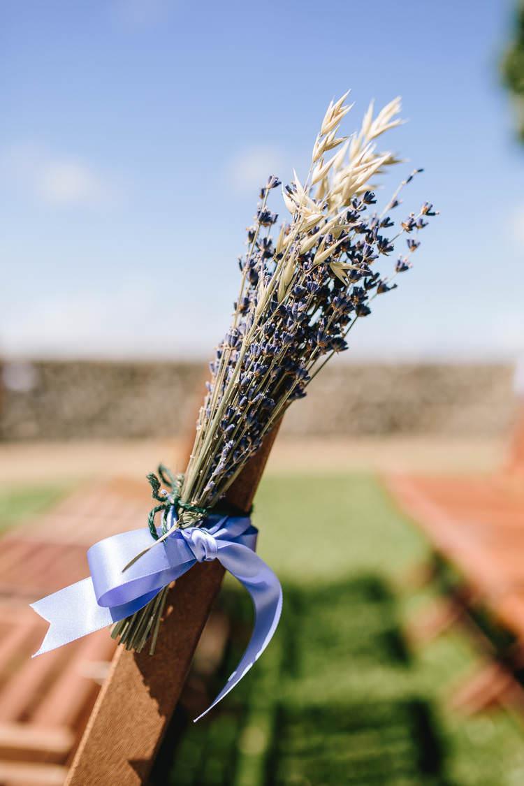 Aisle Decor Lavender Wheat Blue Ribbon Pretty Picturesque Outdoor Castle Wedding https://parkershots.com/