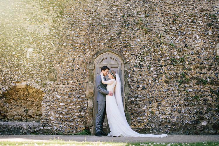 Bride Bridal Dress Long Sleeved Veil Flower Crown Ted Baker Groom Pretty Picturesque Outdoor Castle Wedding https://parkershots.com/