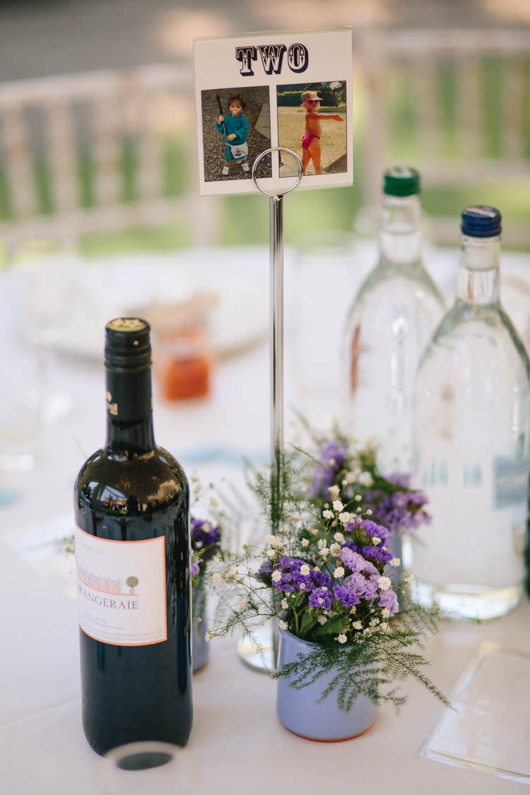 Table Number Centre Pot Gypsophila Purple Flowers Pretty Picturesque Outdoor Castle Wedding https://parkershots.com/