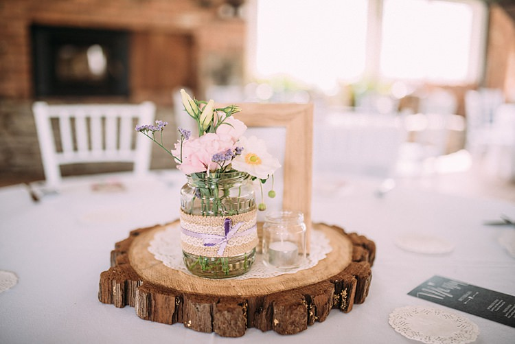 Centrepiece Decor Log Jar Flowers Candle Beautiful Lilac Garden Wedding New Zealand http://www.levienphotography.com/