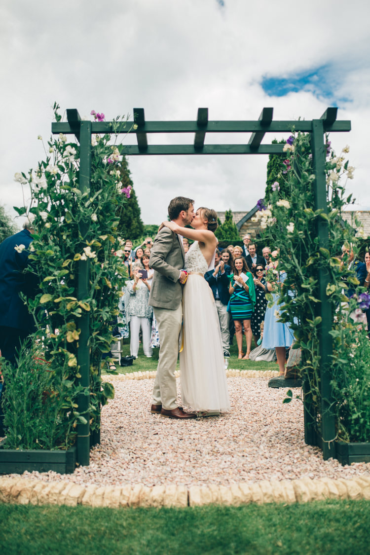 Outdoor Ceremony Arch Flowers Wildflower Village Green Handfasting Wedding http://www.naomijanephotography.com/
