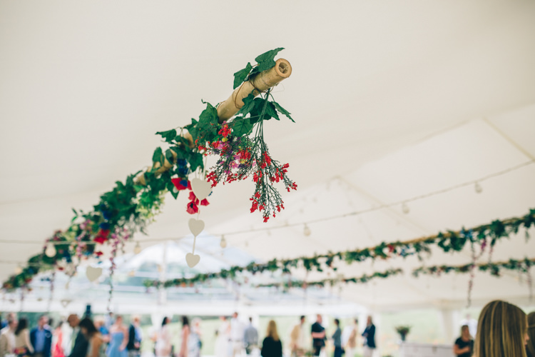 Hanging Flowers Foliage Greenery Marquee Wildflower Village Green Handfasting Wedding http://www.naomijanephotography.com/