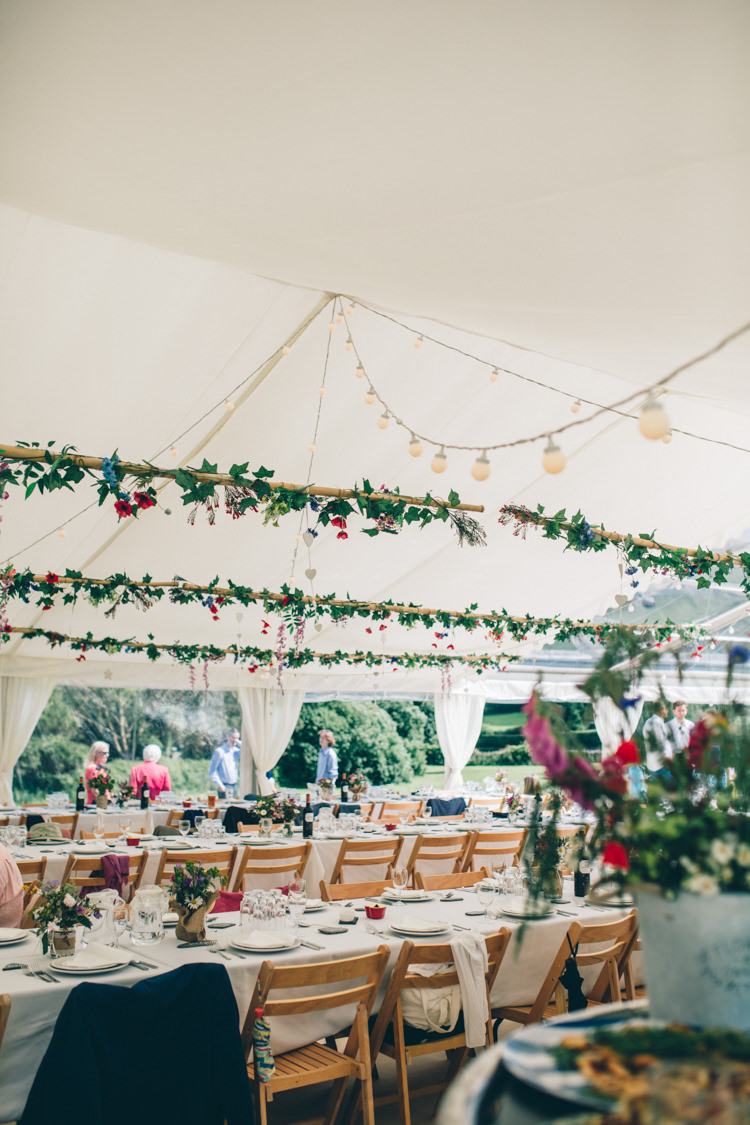 Marquee Festoon Lights Hanging Foliage Flowers Greenery Wildflower Village Green Handfasting Wedding http://www.naomijanephotography.com/