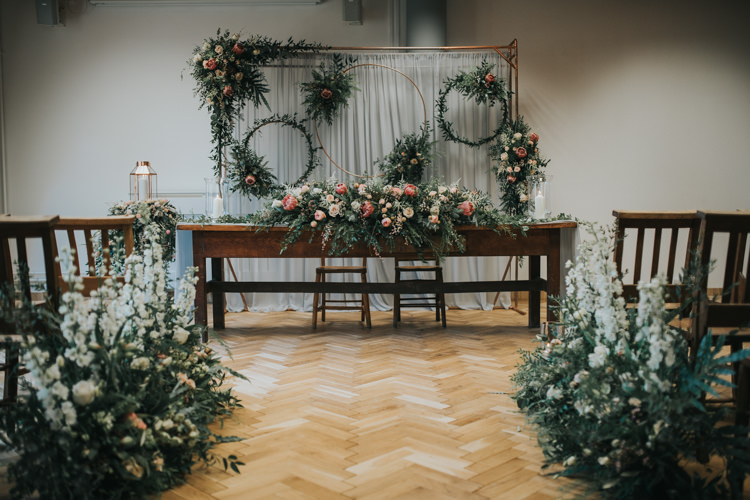 Ceremony Flowers Backdrop Hoops Foliage Aisle Pew End Chairs Table Industrial Into The Wild Greenery Wedding Ideas http://www.ivoryfayre.com/
