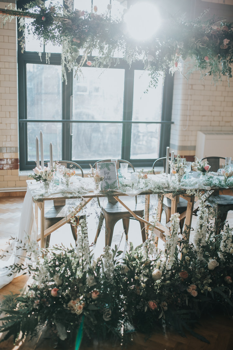 Table Flowers Floor Ceiling Hanging Foliage Decor Table Scape Industrial Into The Wild Greenery Wedding Ideas http://www.ivoryfayre.com/