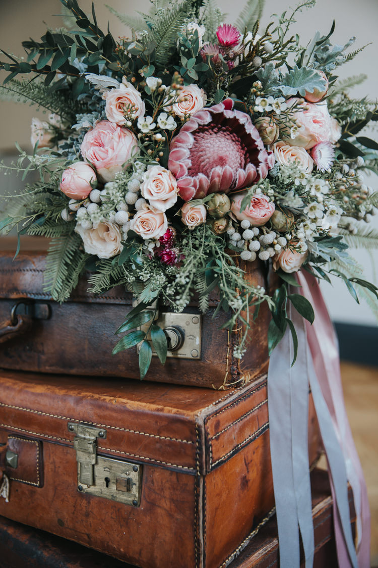 Bouquet Flowers Pink Foliage Roses Protea Bride Bridal Ribbons Industrial Into The Wild Greenery Wedding Ideas http://www.ivoryfayre.com/