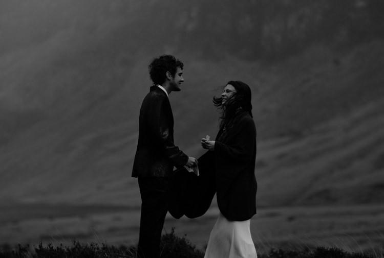 Bride Beaded Chiffon Bridal Gown Black Wrap Groom Black Tailored Suit White Shirt Black Tie Rain Wind Breathtaking Wild Scotland Elopement http://www.theferros.com/
