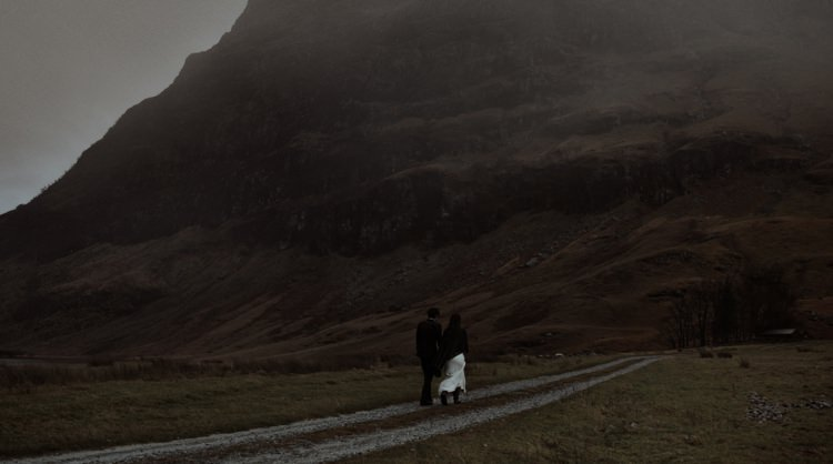Bride Beaded Chiffon Bridal Gown Black Wrap Groom Black Tailored Suit Hills Clouds Breathtaking Wild Scotland Elopement http://www.theferros.com/