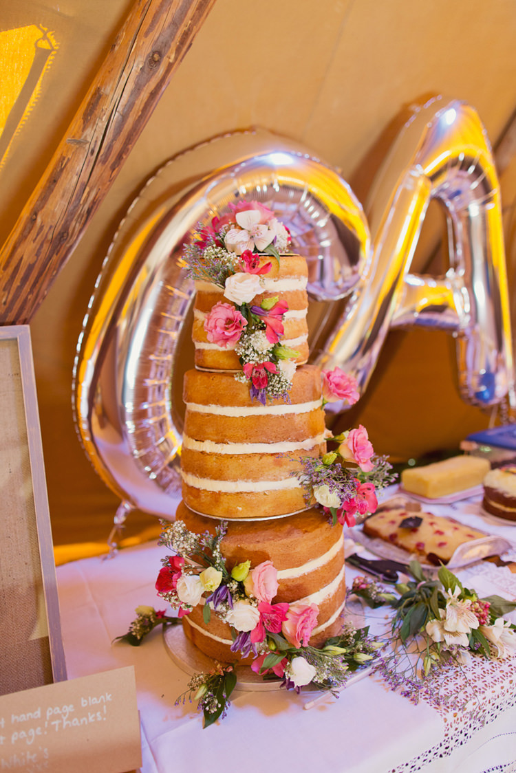 Naked Cake Tower Sponge Layer Relaxed Festival Tipi Wedding http://www.cottoncandyweddings.co.uk/