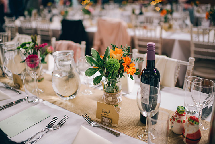 Table Setting Jars Multicoloured Flowers Hessian Colourful Fun Party Brighton Wedding http://jmcsweeneyphotography.co.uk/