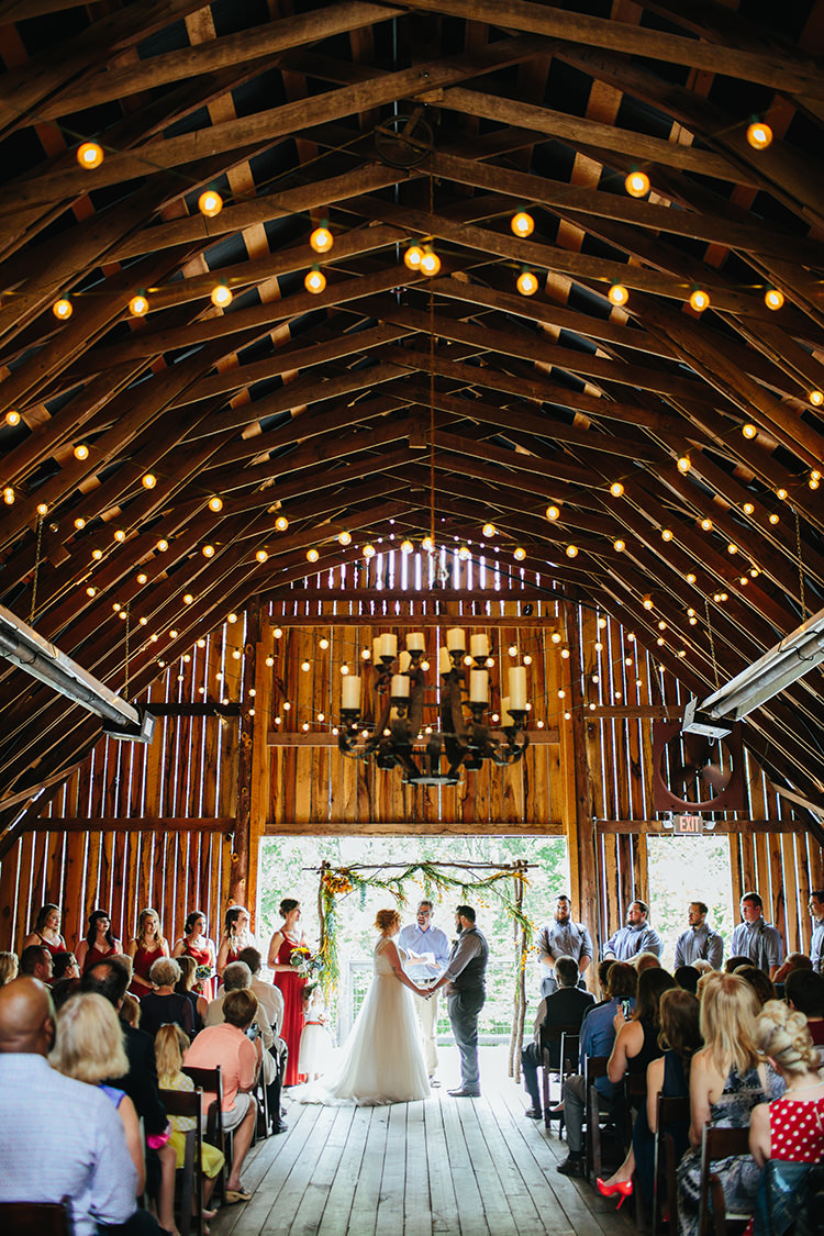Indoor Barn Ceremony Bride Groom Floral Arch Bridal Party Guests Fairy Lights Candlesticks Creative Quirky Rustic Barn Wedding Tennessee http://www.alexbeephoto.com/