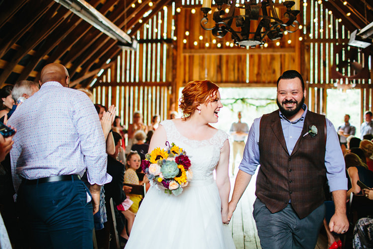 Indoor Barn Ceremony Just Married Bride Lace Tulle Bridal Gown Multicoloured Bouquet Groom Dark Grey Pants Light Grey Shirt Custom Vest Guests Fairy Lights Creative Quirky Rustic Barn Wedding Tennessee http://www.alexbeephoto.com/
