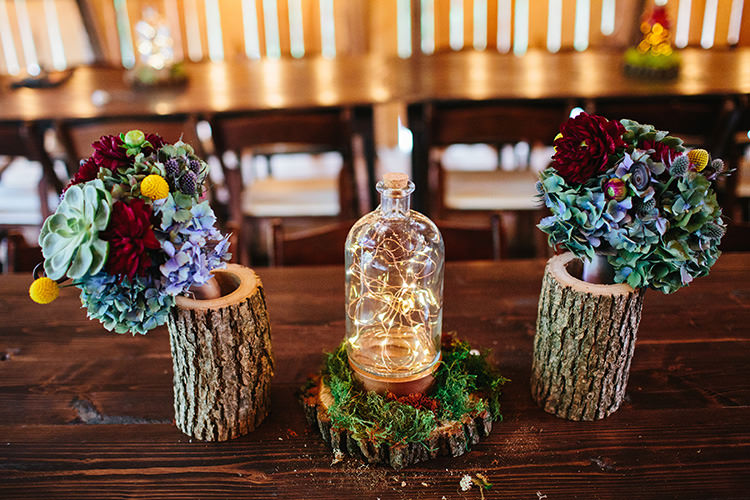 Reception Tree Trunk Vases Multicoloured Blooms Succulents Fairy Light Bottles Greenery Creative Quirky Rustic Barn Wedding Tennessee http://www.alexbeephoto.com/